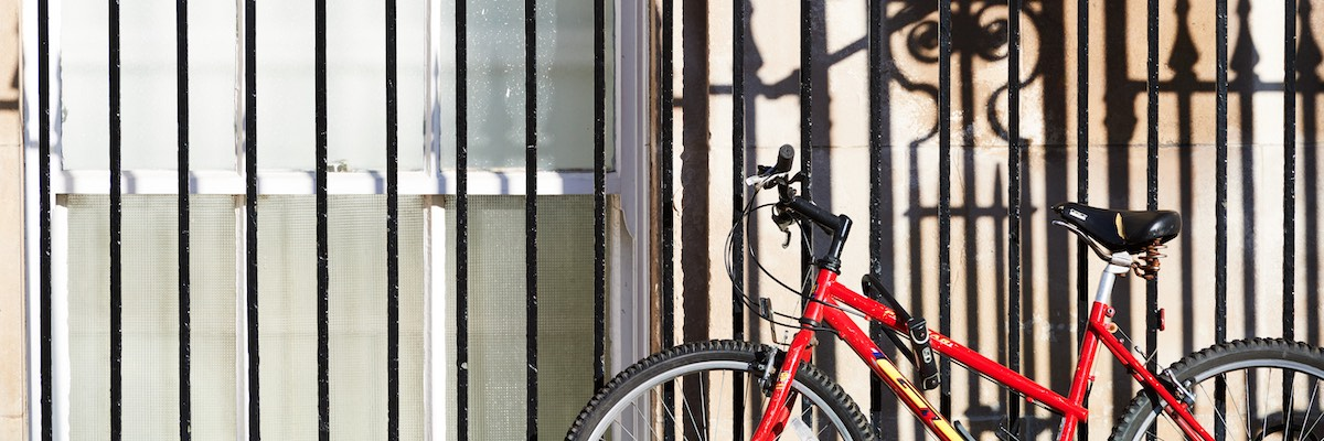 Bicycle locked securely to railings at University of Portsmouth