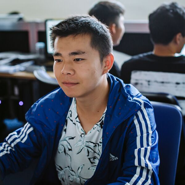 Male student working on computer in computer lab