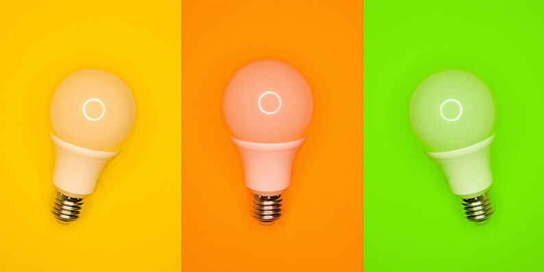 3 colourful light bulbs