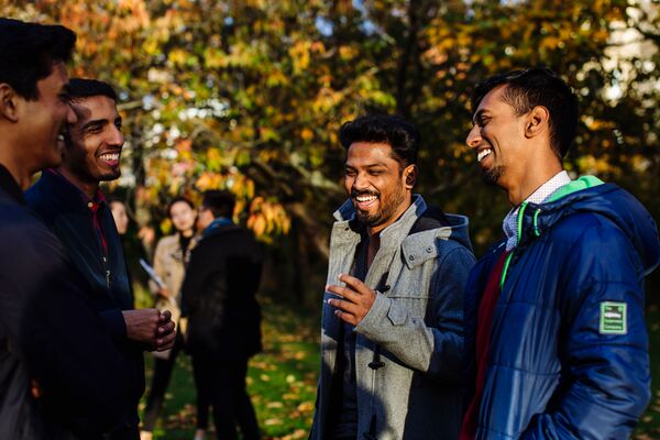 Group of international students laughing in park