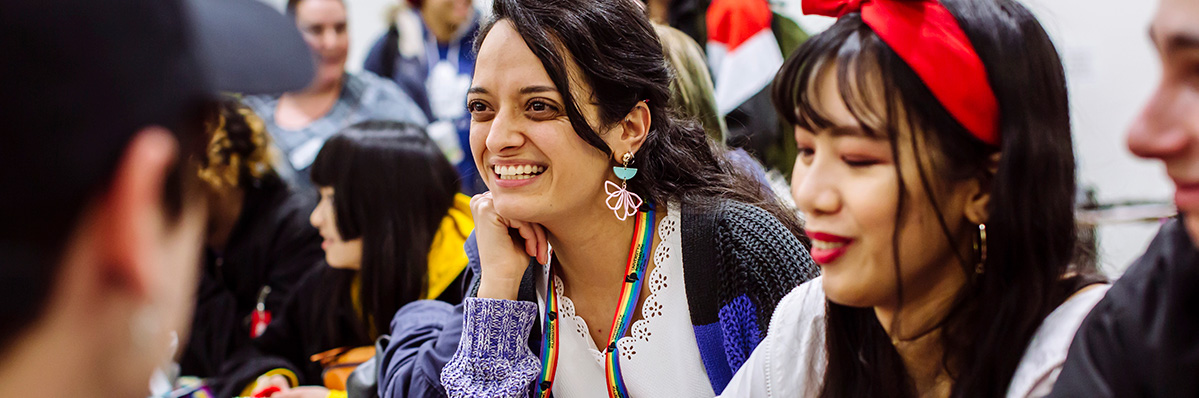 Group of students laugh and smile at the feel good festival