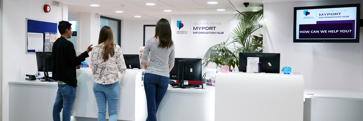 Students standing at MyPort information hub