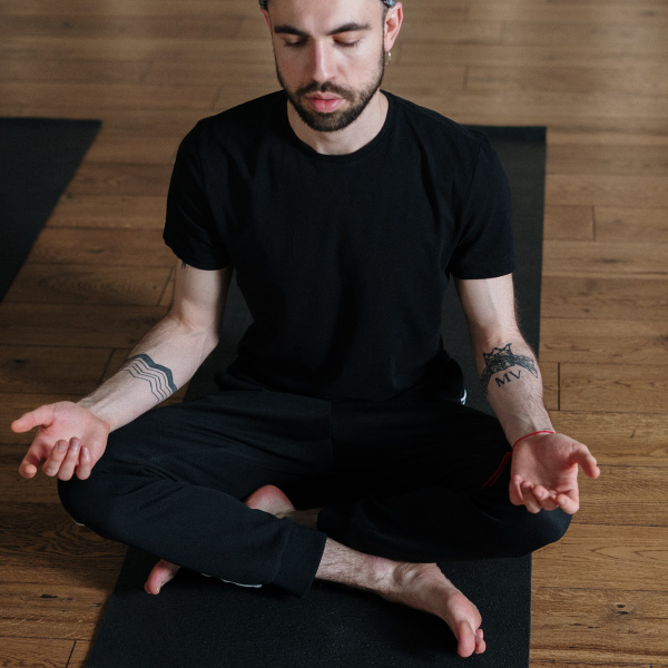 Male student in yoga class