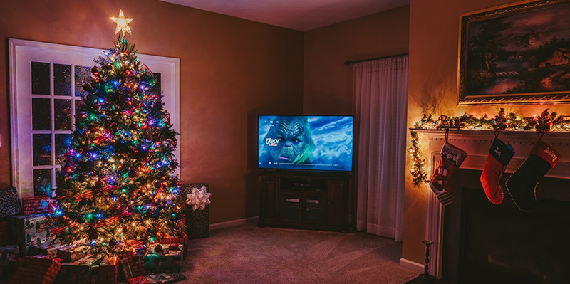 christmas living room with The Grinch on TV