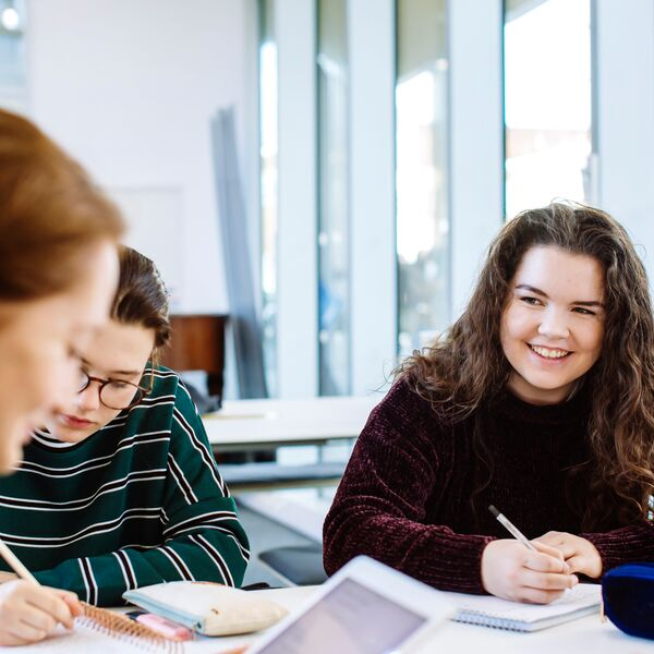 Group of students revising together and smiling